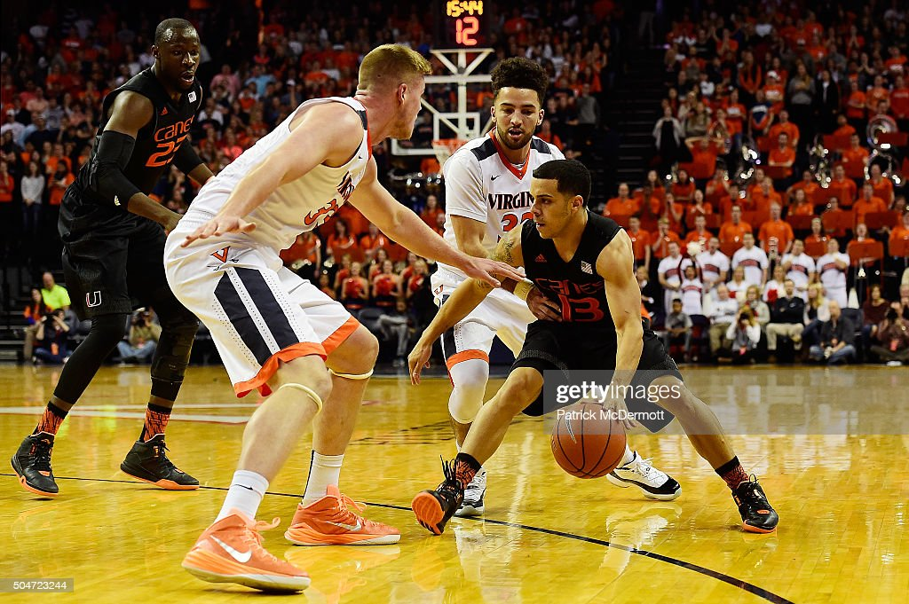 <a gi-track='captionPersonalityLinkClicked' href=/galleries/search?phrase=Angel+Rodriguez+-+Basketballer&family=editorial&specificpeople=10584461 ng-click='$event.stopPropagation()'>Angel Rodriguez</a> #13 of the Miami Hurricanes dribbles the ball against Jack Salt #33 of the Virginia Cavaliers in the first half during a game at John Paul Jones Arena on January 12, 2016 in Charlottesville, Virginia.