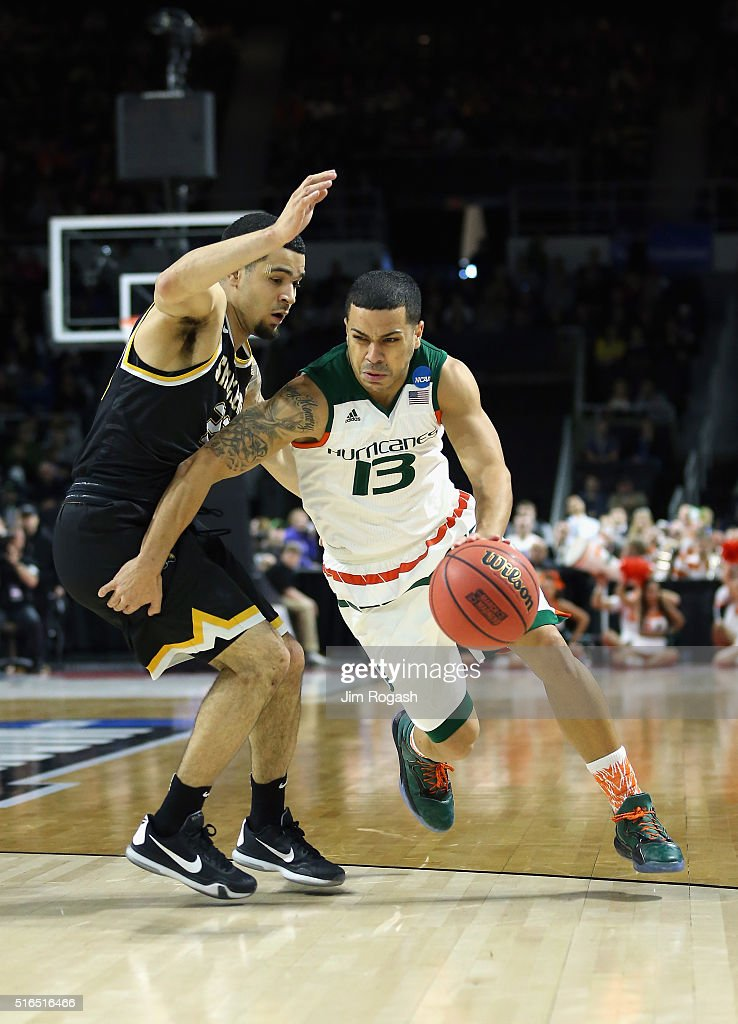 Angel Rodriguez of the Miami Hurricanes drives against Fred VanVleet of the Wichita State Shockers in the first half of their game during the second...