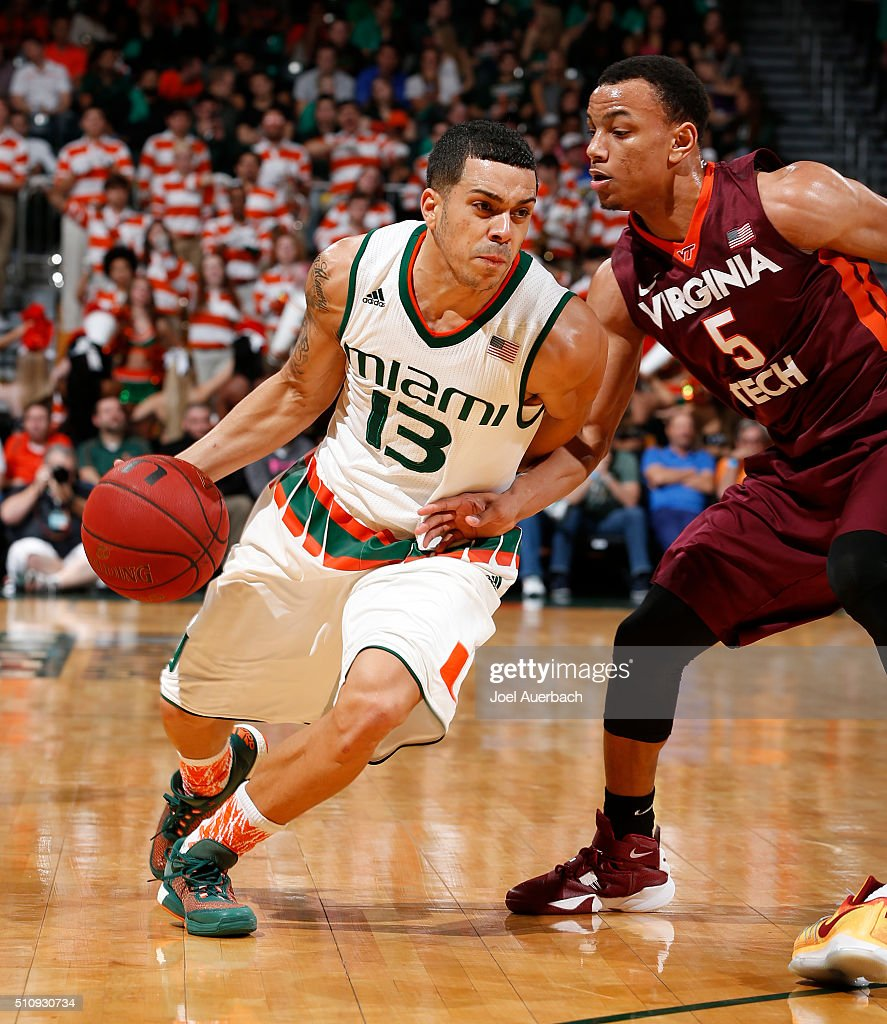 Angel Rodriguez of the Miami Hurricanes drives to the basket against Justin Robinson of the Virginia Tech Hokies on February 17 2016 at the...