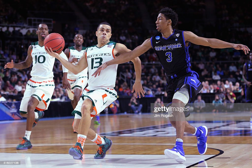 Angel Rodriguez of the Miami Hurricanes drives to the basket against CJ Massinburg of the Buffalo Bulls in the first half of their game during the...