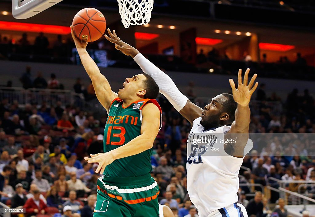 Angel Rodriguez of the Miami Hurricanes drives to the basket against Daniel Ochefu of the Villanova Wildcats in the second half of their game during...