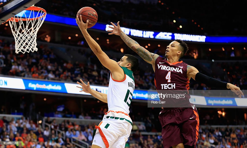 Angel Rodriguez of the Miami Hurricanes puts up a shot in front of Seth Allen of the Virginia Tech Hokies in the first half during the quarterfinals...