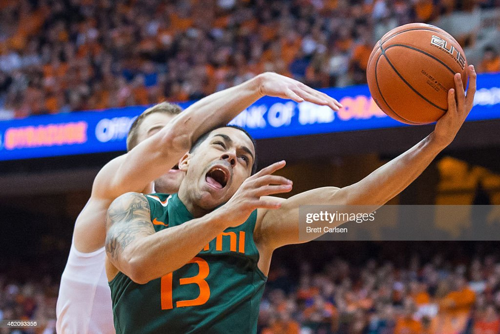 Angel Rodriguez of the Miami Hurricanes reacts to a foul by Trevor Cooney of the Syracuse Orange during the second half on January 24 2015 at The...