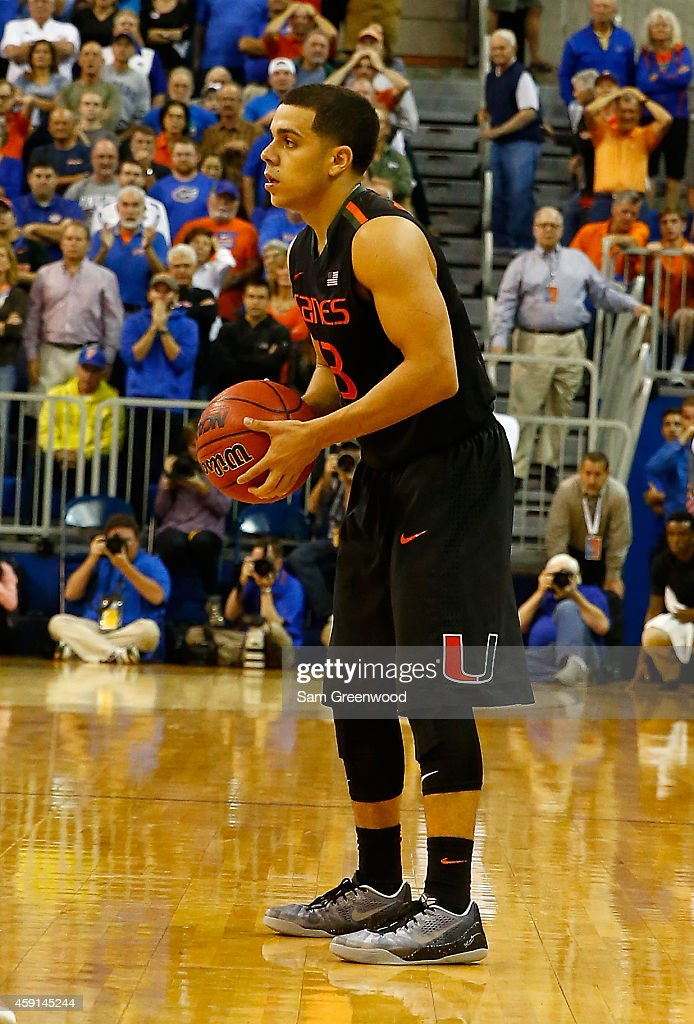 Angel Rodriguez of the Miami Hurricanes sets up the offense during the game against the Florida Gators at Stephen C O'Connell Center on November 17...