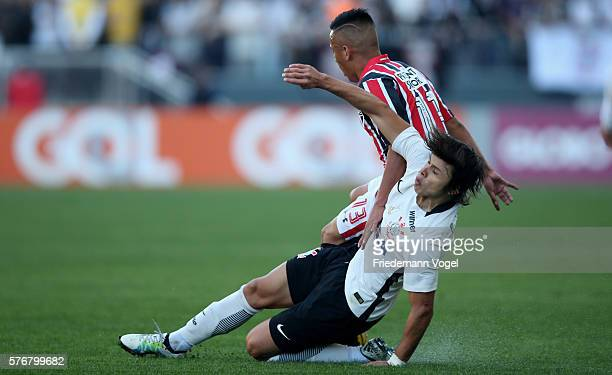 Angel Romero of Corinthians fights for the ball with Cueva of Sao Paulo during the match between Corinthians and Sao Paulo for the Brazilian Series A...
