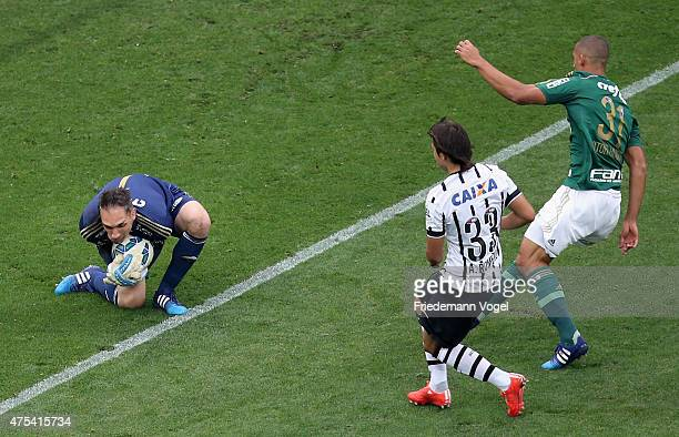 Angel Romero of Corinthians fights for the ball with Fernando Prass and Victor Hugo of Palmeiras during the match between Corinthians and Palmeiras...