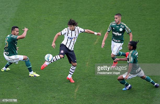 Angel Romero of Corinthians fights for the ball with Jackson Victor Hugo and Arouca of Palmeiras during the match between Corinthians and Palmeiras...