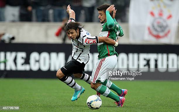 Angel Romero of Corinthians fights for the ball with Victor Luis of Palmeiras during the match between Corinthians and Palmeiras for the Brazilian...