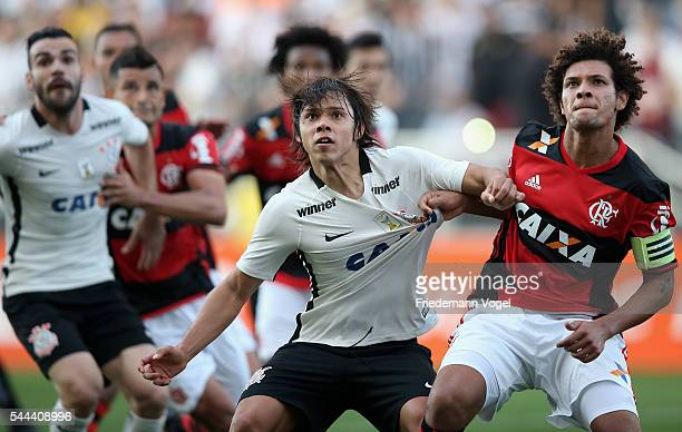 Angel Romero of Corinthians fights for the ball with Willian Arao of Flamengo during the match between Corinthians and Flamengo for the Brazilian...