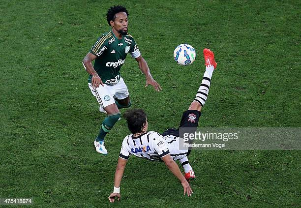 Angel Romero of Corinthians fights for the ball with Ze Roberto of Palmeiras during the match between Corinthians and Palmeiras for the Brazilian...
