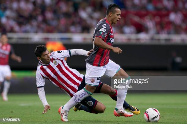 Angel Saldivar of Chivas fights for the ball with Mario de Luna of Necaxa during the third round match between Chivas and Necaxa as part of the...