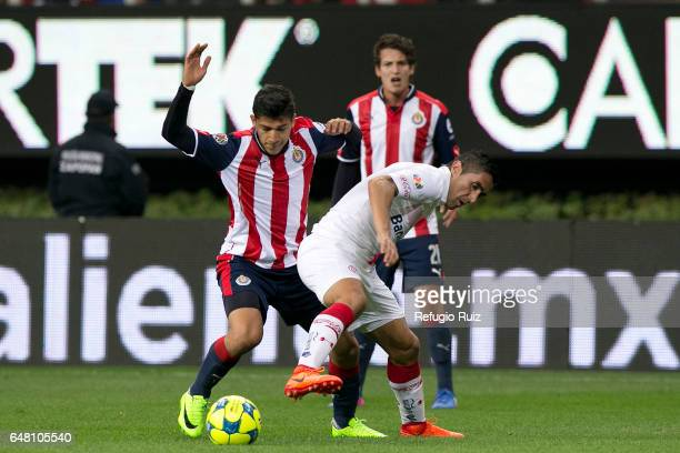 Angel Saldivar of Chivas fights for the ball with Osvaldo Gonzalez of Toluca during the 9th round match between Chivas and Toluca as part of the...