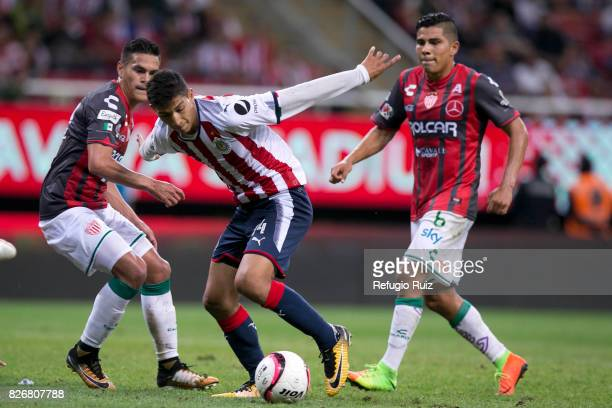 Angel Saldivar of Chivas fights for the ball with Xavier Baez of Necaxa during the third round match between Chivas and Necaxa as part of the Torneo...