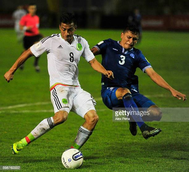 Angel Sepulveda of Mexico fights for the ball with Roberto Dominguez of El Salvador during a match between El Salvador and Mexico as part of FIFA...