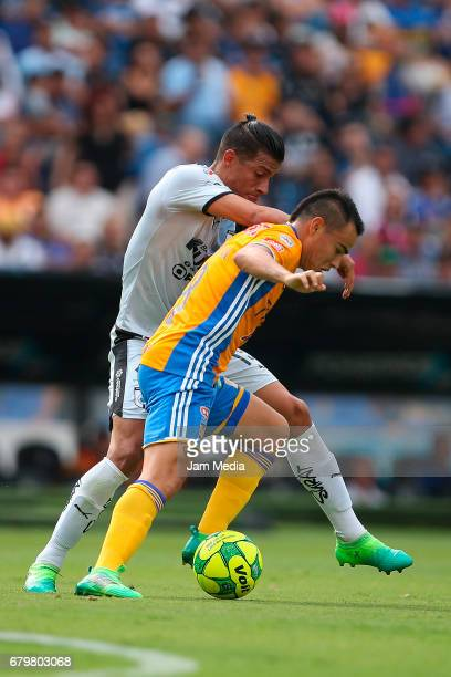 Angel Sepulveda of Queretaro and Lucas Zelarayan of Tigres fight for the ball during a match between Queretaro against Tigres as part of the Clausura...