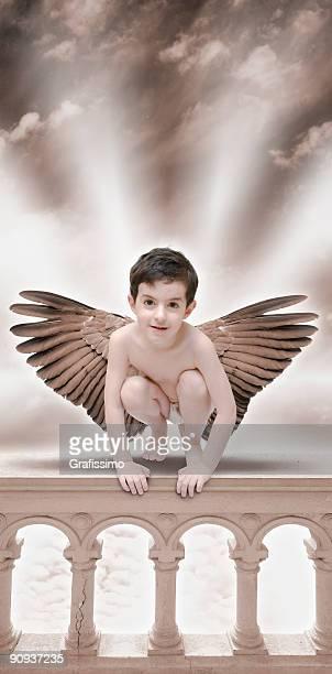 Angel sitting on balustrade