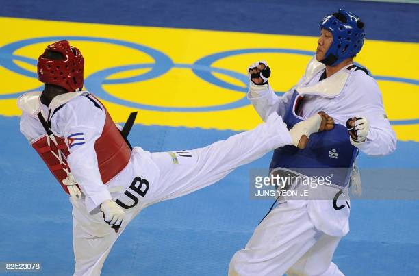 Angel Valodia Matos of Cuba lands a kick on Liu Xiaobo of China in the quarterfinal of the men's 80 kg taekwondo competition during the 2008 Beijing...