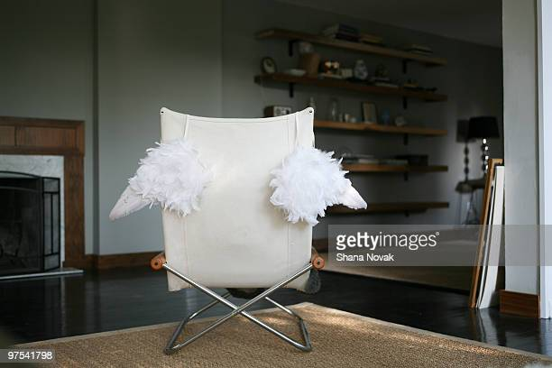 Angel Wings Hanging on a Living Room Chair