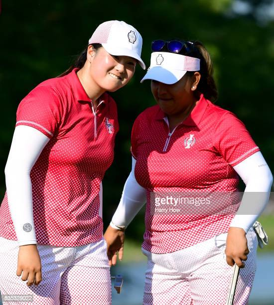 Angel Yin and Lizette Salas of Team USA celebrate a six and five win over Team Europe on the the 13th green during the afternoon fourball matches of...