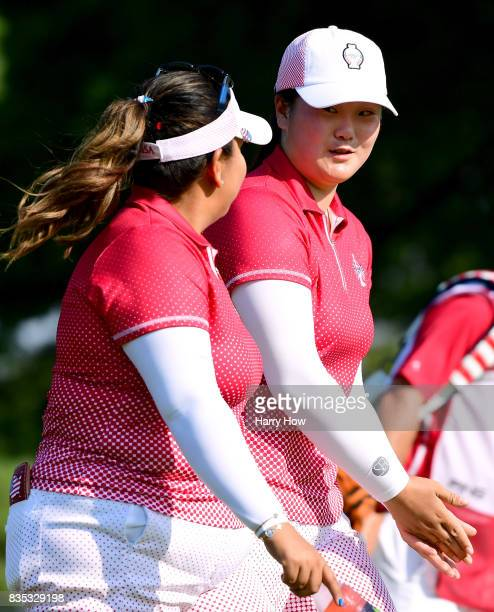 Angel Yin and Lizette Salas of Team USA talk walking up the 13th fairway five up on Team Europe during the afternoon fourball matches of the Solheim...
