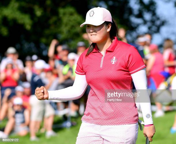 Angel Yin of Team USA celebrates a birdie putt on the 12th green during the afternoon fourball matches of the Solheim Cup at the Des Moines Golf and...