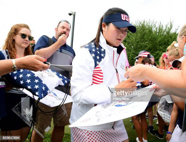Angel Yin of Team USA signs autographs during practice for the Solheim Cup at the Des Moines Golf and Country Club on August 17 2017 in West Des...