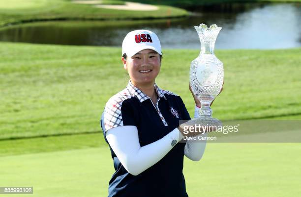 Angel Yin of the United States Team holds the Solheim Cup after the closing ceremony during the final day singles matches in the 2017 Solheim Cup at...