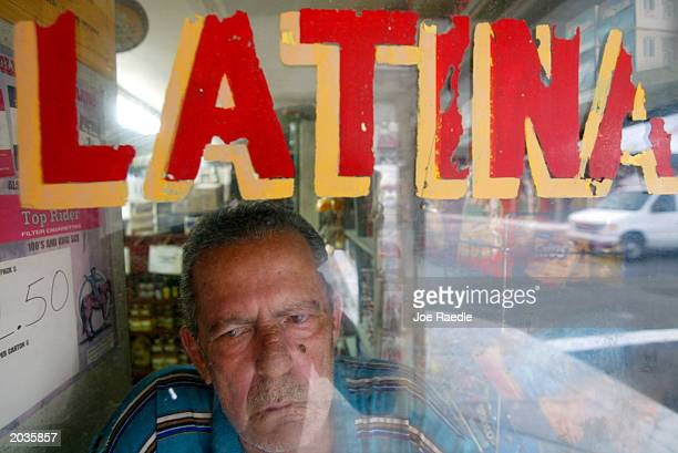 Angel Yune who came to America from Cuba looks out the window of a store May 28 2003 in Miami Yune represents part of the largest and fastest growing...