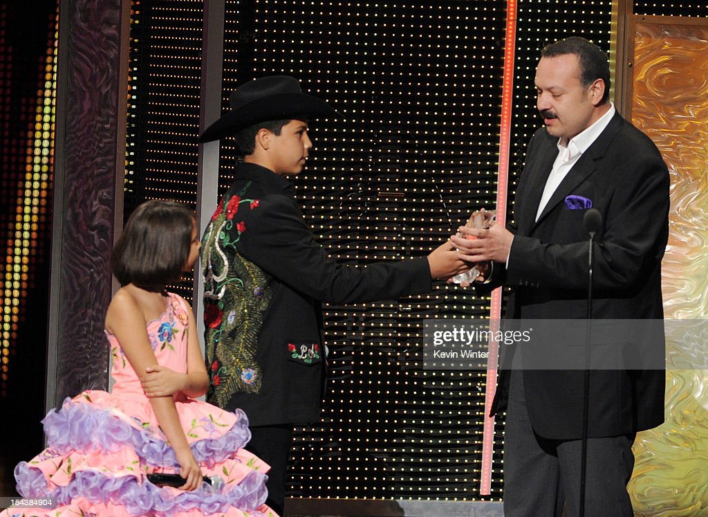 Angela Aguilar and Leonardo Aguilar present the Legado Musical award to their father <a gi-track='captionPersonalityLinkClicked' href=/galleries/search?phrase=Pepe+Aguilar&family=editorial&specificpeople=2496118 ng-click='$event.stopPropagation()'>Pepe Aguilar</a> at the Billboard Mexican Music Awards presented by State Farm on October 18, 2012 in Los Angeles, California.