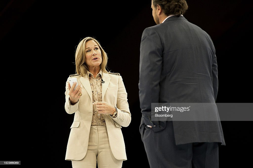 Angela Ahrendts, chief executive officer of Burberry Group Plc, left speaks while <a gi-track='captionPersonalityLinkClicked' href=/galleries/search?phrase=Marc+Benioff&family=editorial&specificpeople=6871116 ng-click='$event.stopPropagation()'>Marc Benioff</a>, chairman and chief executive officer of Salesforce.com Inc., listens during a keynote address at the DreamForce Conference in San Francisco, California, U.S., on Wednesday, Sept. 19, 2012. Salesforce.com Inc. said it's releasing a new version of its software for tablet computers and unifying its social-media marketing products into a single suite, as it races to stay ahead of new market entrants. Photographer: David Paul Morris/Bloomberg via Getty Images