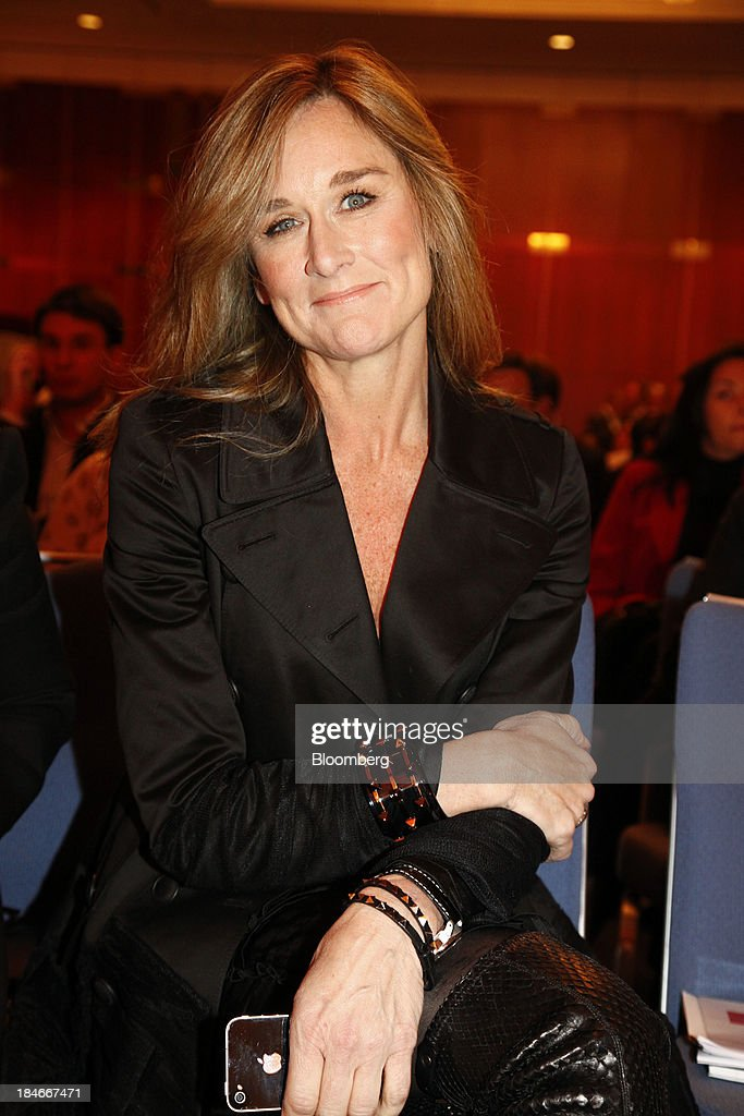 Angela Ahrendts, chief executive officer of Burberry Group Plc, poses for a photograph as she holds an Apple Inc. iPhone before speaking at the World Retail Congress in Berlin, Germany, on Tuesday, Oct. 26, 2010. Burberry Group said Christopher Bailey will become chief executive officer of the largest British luxury-goods producer, as CEO Angela Ahrendts departs the company to work at Apple Inc. Photographer: Michele Tantussi/ Bloomberg