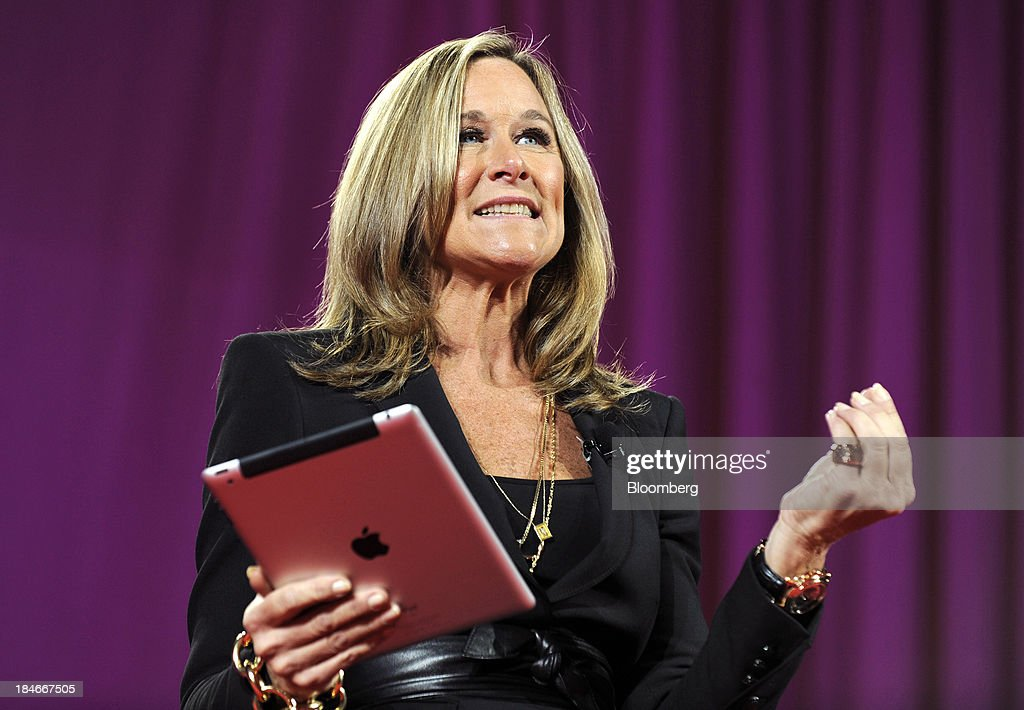 Angela Ahrendts, chief executive officer of Burberry Group Plc, speaks as she holds an Apple Inc. iPad at the 2011 World Business Forum in New York, U.S., on Wednesday, Oct. 5, 2011. Burberry Group said Christopher Bailey will become chief executive officer of the largest British luxury-goods producer, as CEO Angela Ahrendts departs the company to work at Apple Inc. Photographer: Peter Foley/Bloomberg via Getty Images