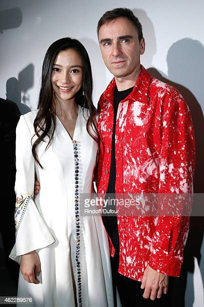 Angela Baby and Fashion Designer Raf Simons pose backstage after Christian Dior show as part of Paris Fashion Week HauteCouture Spring/Summer 2015 on...