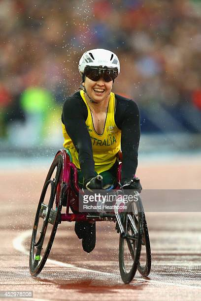 Angela Ballard of Australia smiles after winning gold in the Women's T54 1500 metres final at Hampden Park during day eight of the Glasgow 2014...