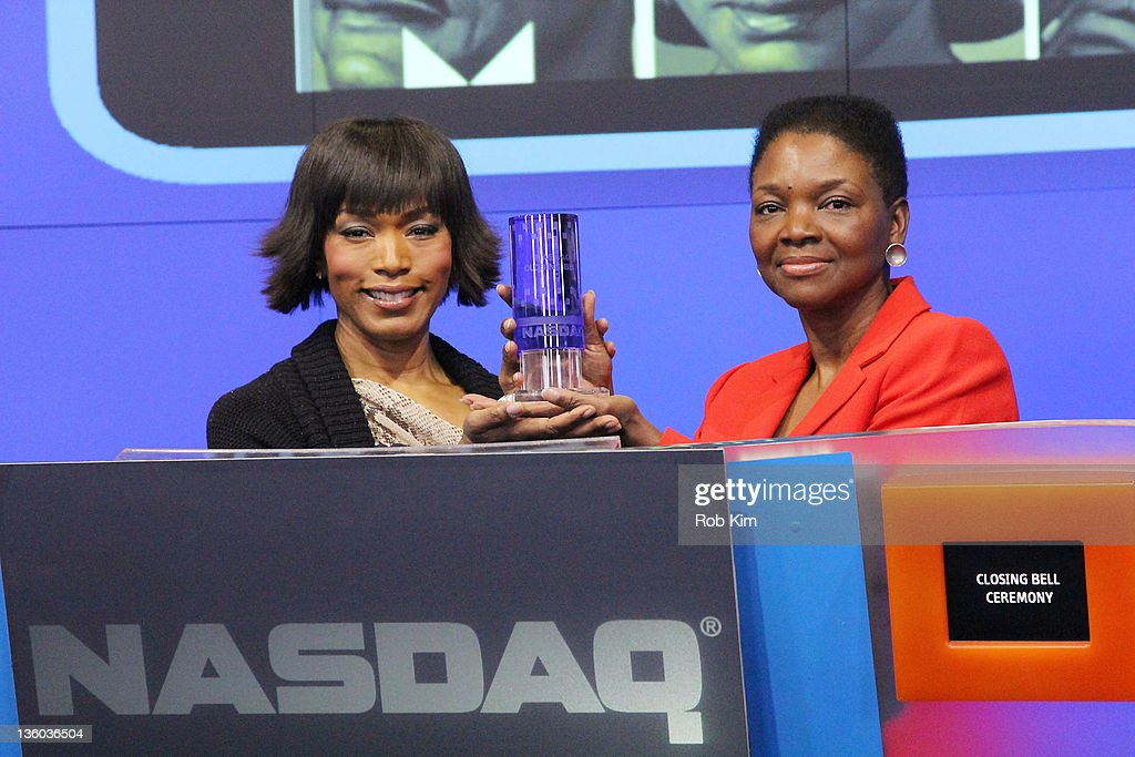 Angela Bassett and Baroness Valerie Amos UN Undersecretary General for Humanitarian Affairs ring the NASDAQ stock market closing bell on December 20...