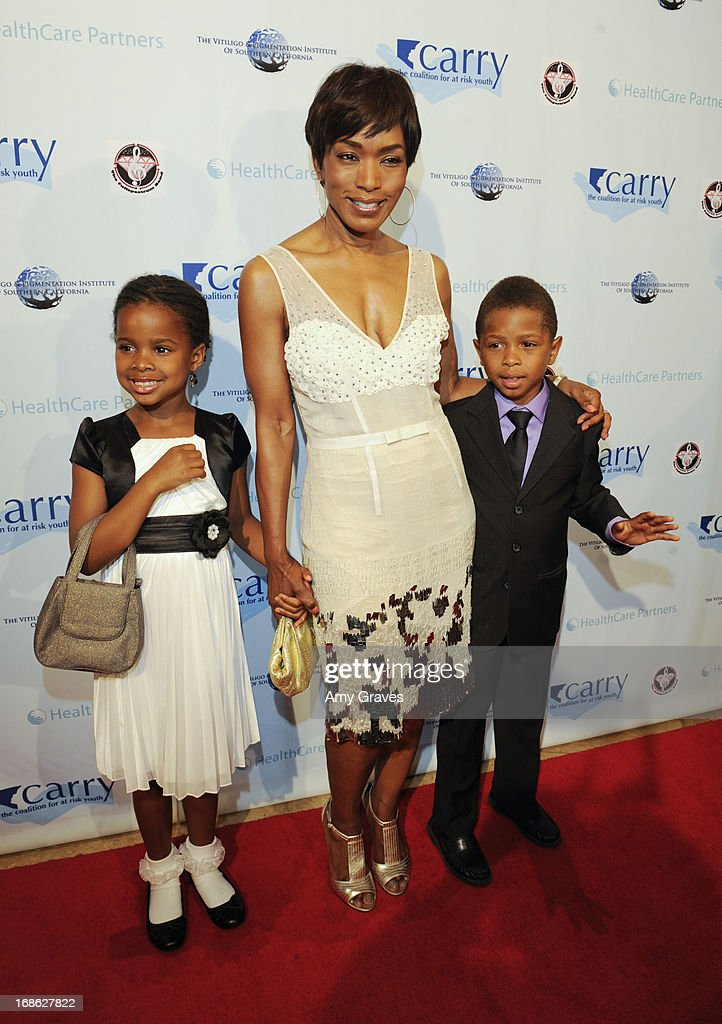 <a gi-track='captionPersonalityLinkClicked' href=/galleries/search?phrase=Angela+Bassett&family=editorial&specificpeople=171174 ng-click='$event.stopPropagation()'>Angela Bassett</a> and children attend the CARRY Foundation's 7th Annual 'Shall We Dance' Gala at The Beverly Hilton Hotel on May 11, 2013 in Beverly Hills, California.
