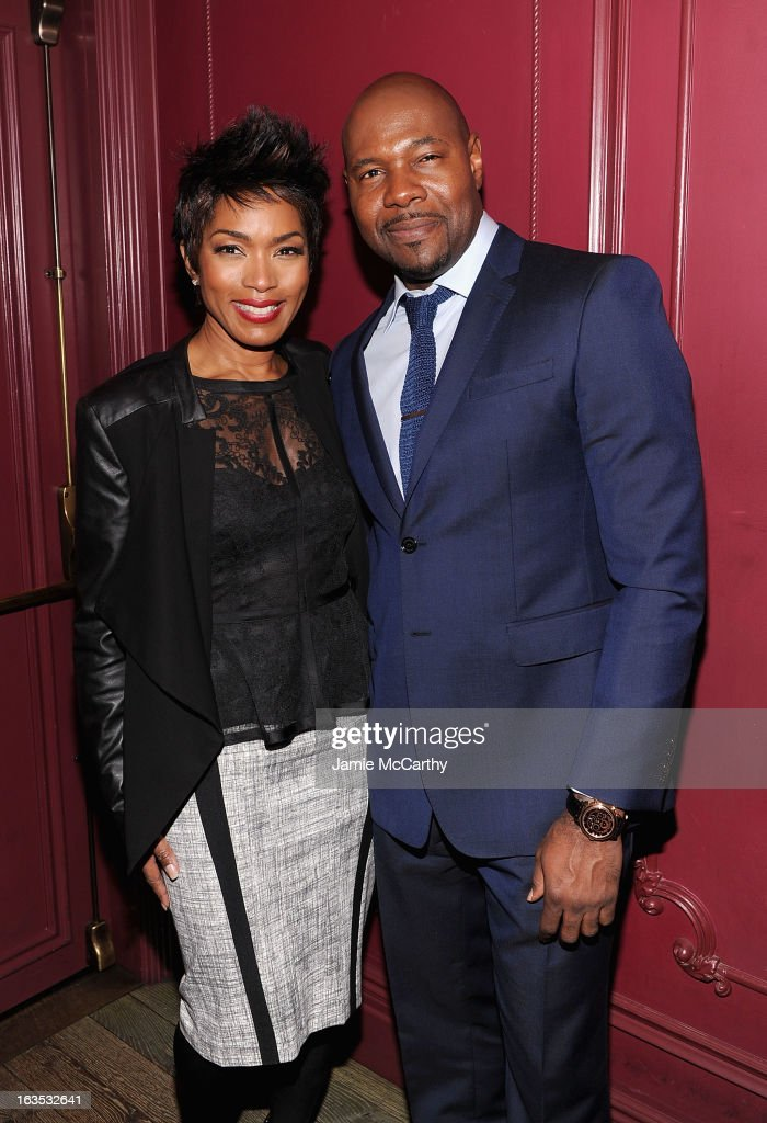 Angela Bassett and director Antoine Fuqua attend the after party for The Cinema Society with Roger Dubuis and Grey Goose screening of FilmDistrict's 'Olympus Has Fallen' at The Darby on March 11, 2013 in New York City.