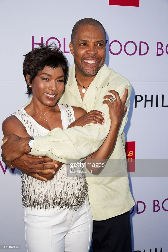 Angela Bassett and Eriq La Salle pose together for a photo at the Hollywood Bowl Hall Of Fame Opening Night at The Hollywood Bowl on June 22, 2013 in Los Angeles, California.