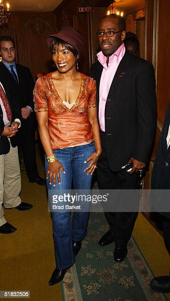 Angela Bassett and husband arrives at the opening of 'The Gem of the Ocean' after party at Barbetta on December 6 2004 in New York