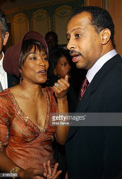 Angela Bassett and Ruben Santiago Hudson arrive at the opening of 'The Gem of the Ocean' after party at Barbetta on December 6 2004 in New York