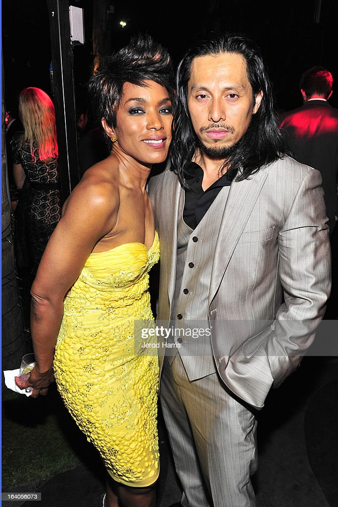Angela Bassett and Sam Medina attend 'Olympus Has Fallen' Premiere Reception presented by Grey Goose Vodka at Lure on March 18, 2013 in Hollywood, California.
