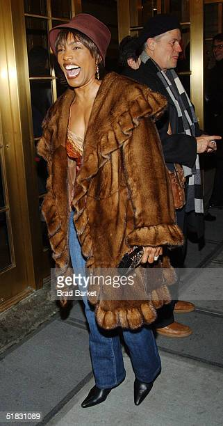 Angela Bassett arrives at the opening of 'The Gem of the Ocean' at the Walter Kerr Theatre on December 6 2004 in New York