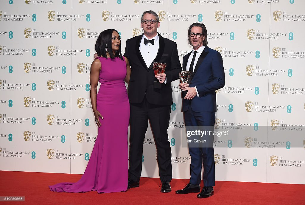 <a gi-track='captionPersonalityLinkClicked' href=/galleries/search?phrase=Angela+Bassett&family=editorial&specificpeople=171174 ng-click='$event.stopPropagation()'>Angela Bassett</a> poses with Best Adapted Screenplay winners <a gi-track='captionPersonalityLinkClicked' href=/galleries/search?phrase=Adam+McKay&family=editorial&specificpeople=744172 ng-click='$event.stopPropagation()'>Adam McKay</a> and <a gi-track='captionPersonalityLinkClicked' href=/galleries/search?phrase=Charles+Randolph&family=editorial&specificpeople=866897 ng-click='$event.stopPropagation()'>Charles Randolph</a> in the winners room at the EE British Academy Film Awards at the Royal Opera House on February 14, 2016 in London, England.