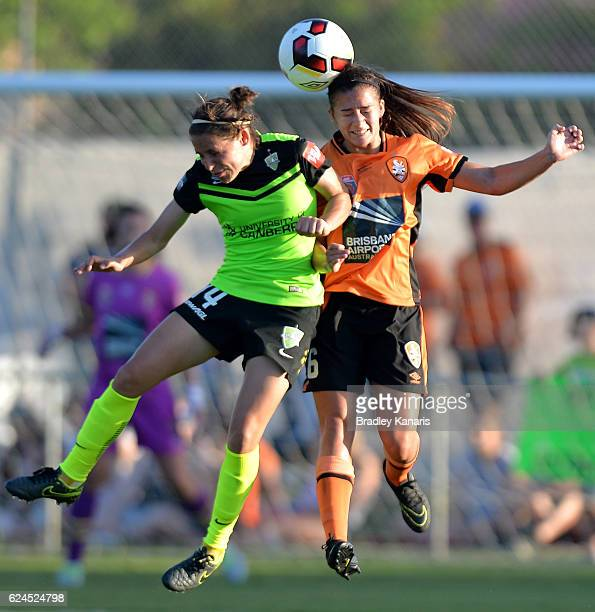 Angela Beard of the Roar and Ashleigh Sykes of Canberra compete for the ball during the round three WLeague match between the Brisbane Roar and...