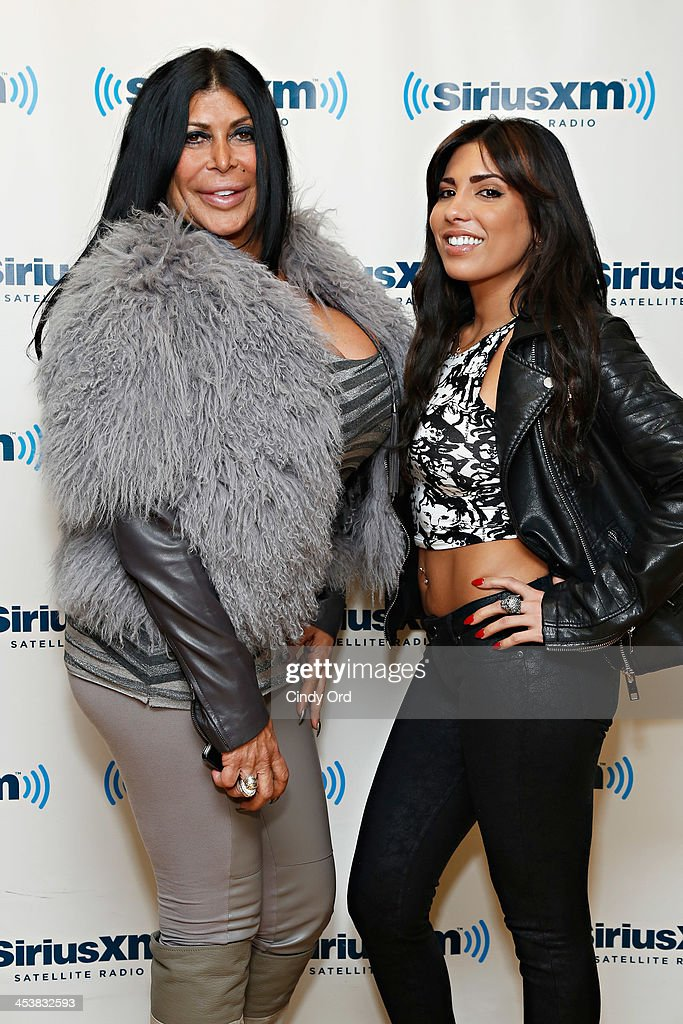 Angela '<a gi-track='captionPersonalityLinkClicked' href=/galleries/search?phrase=Big+Ang&family=editorial&specificpeople=8749866 ng-click='$event.stopPropagation()'>Big Ang</a>' Raiola and Natalie Guercio visit the SiriusXM Studios on December 5, 2013 in New York City.