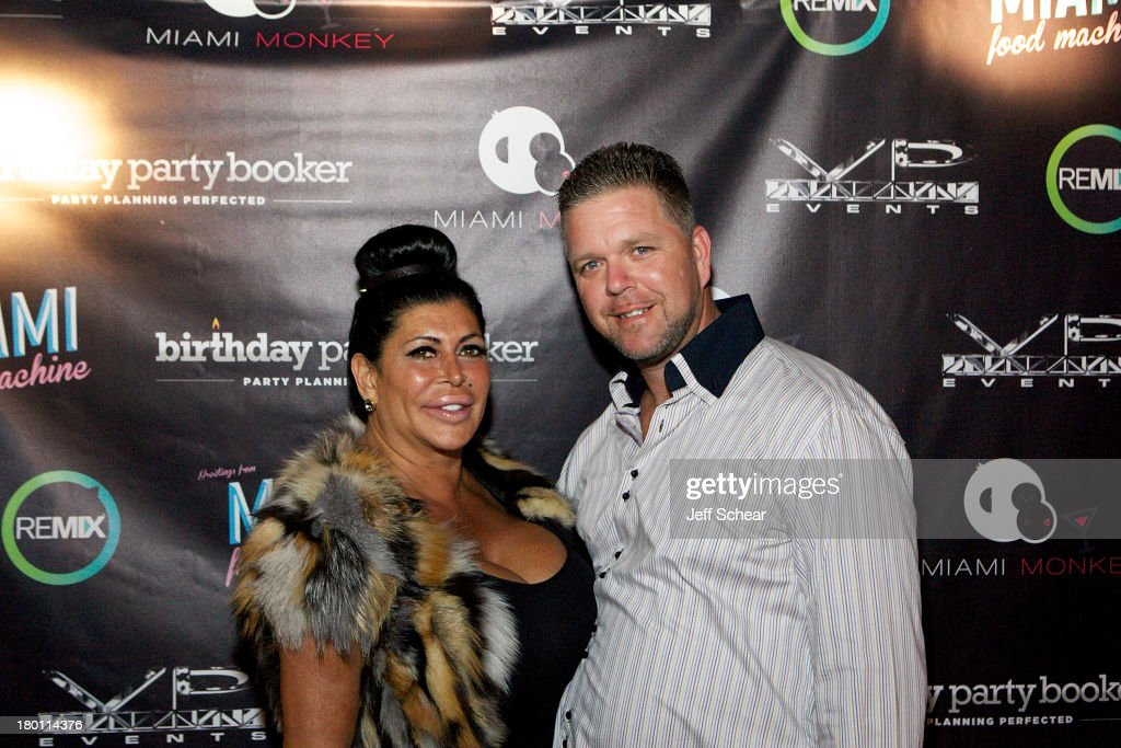 Angela '<a gi-track='captionPersonalityLinkClicked' href=/galleries/search?phrase=Big+Ang&family=editorial&specificpeople=8749866 ng-click='$event.stopPropagation()'>Big Ang</a>' Raiola and Neil Murphy attend the MIAMI MONKEY Premiere Party Presented By JustJenn Productions And The Weinstein Company at 49 Grove on September 8, 2013 in New York City.