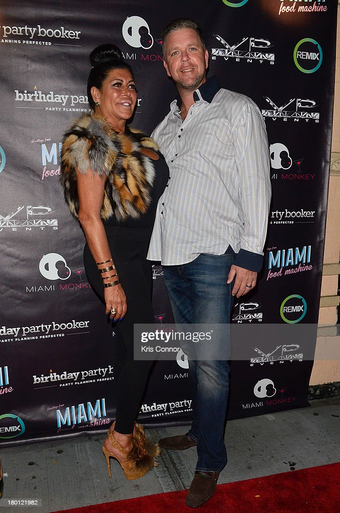 Angela 'Big Ang' Raiola and Neil Murphy pose for photos during the 'Miaimi Monkey' New Screening at 49 Grove on September 8, 2013 in New York City.