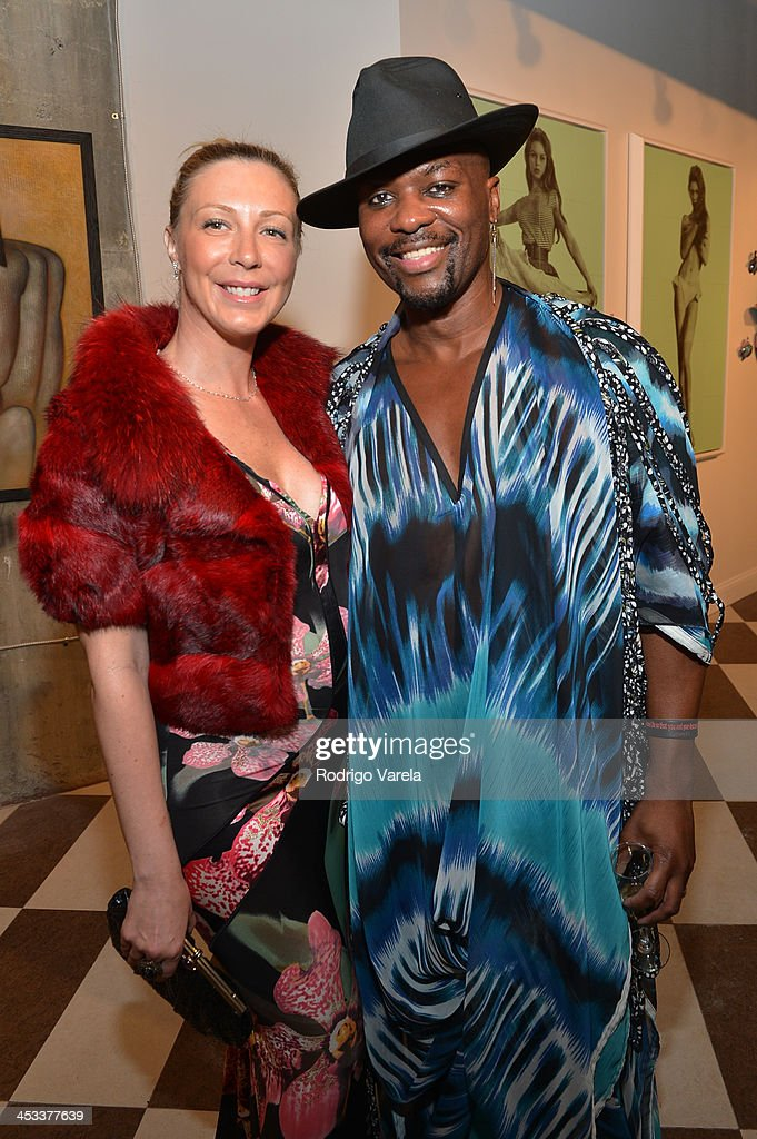 Angela Birdman and Malcom Harris attend the Roman Kriheli Un:veiled Exhibit At Avant Gallery, Featuring The Unveiling Of 'The Most Beautiful Woman In The World' Painting at Epic Hotel on December 3, 2013 in Miami, Florida.