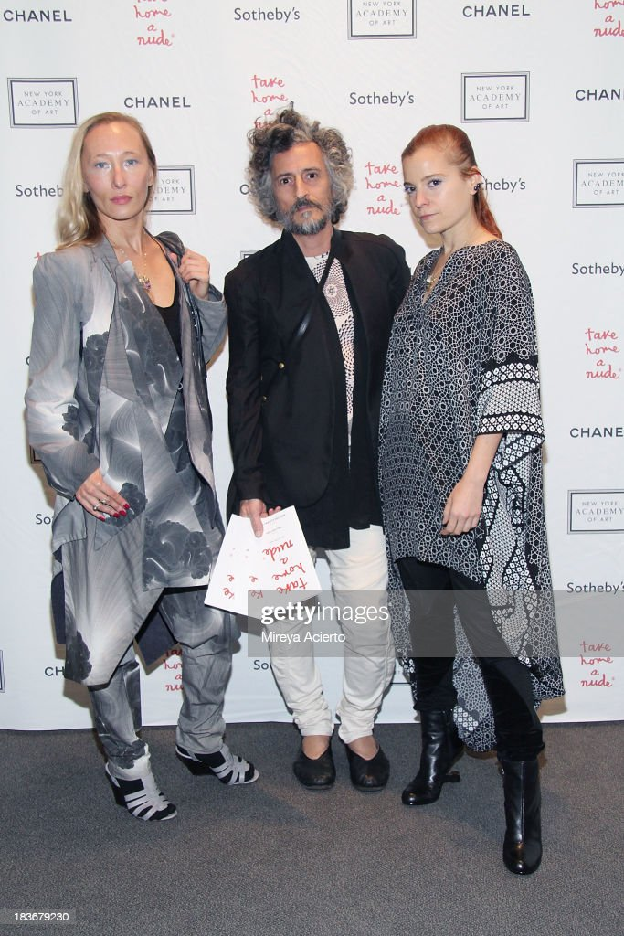 Angela Donhauser, Gabi Asfour and Adi Gil attend the 2013 'Take Home A Nude' Benefit Art Auction And Party at Sotheby's on October 8, 2013 in New York City.