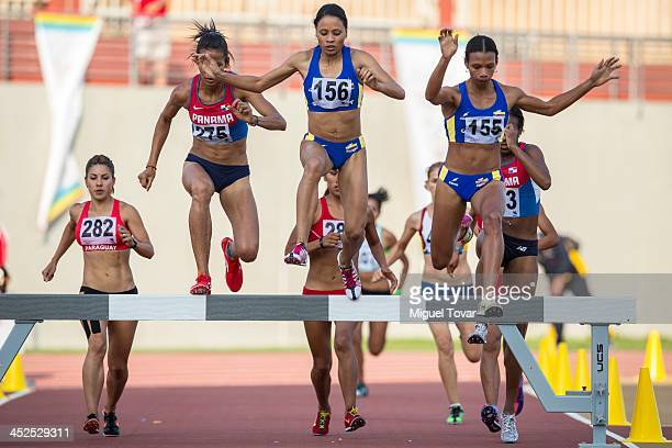 Angela Figueroa of colombia leads in women's 3000m steeplechase final as part of the XVII Bolivarian Games Trujillo 2013 at Chan Chan Stadium on...